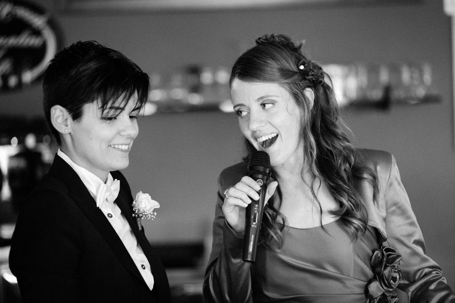 lesbian bride and groom singing during their gay wedding in italy