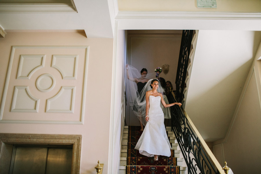 bride walking down the stairs at Villa Cortine Palace Hotel Sirmione, lake garda italy.