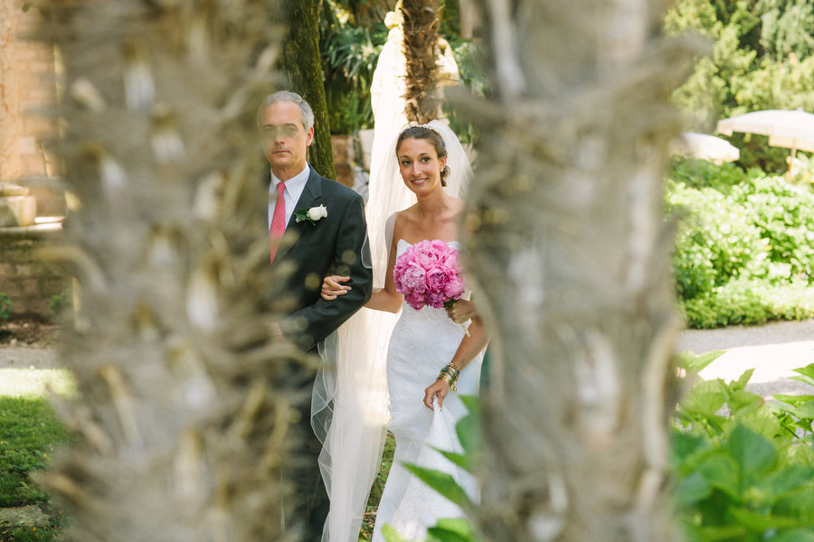 father and bride walking down the isle to the wedding ceremony at Villa Cortine Palace Hotel, Lake Garda, Italy