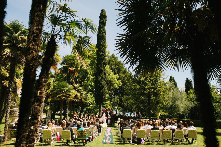 bride and groom at wedding ceremony in the garden of Villa Cortine Palace Hotel, Lake Garda, Italy