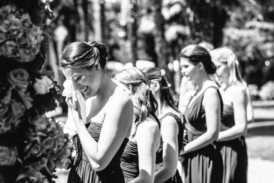 bridesmaid crying during wedding ceremony in the garden of Villa Cortine Palace Hotel, Lake Garda, Italy