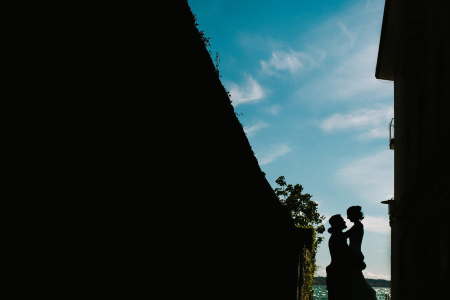 bride and groom silhouette portrait at lake garda, italy, sirmione