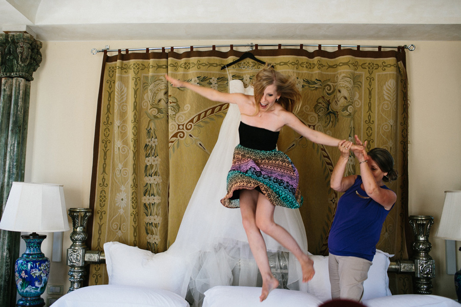 Bride Jumping from Bed during Dress Getting Ready Villa Mangiaca