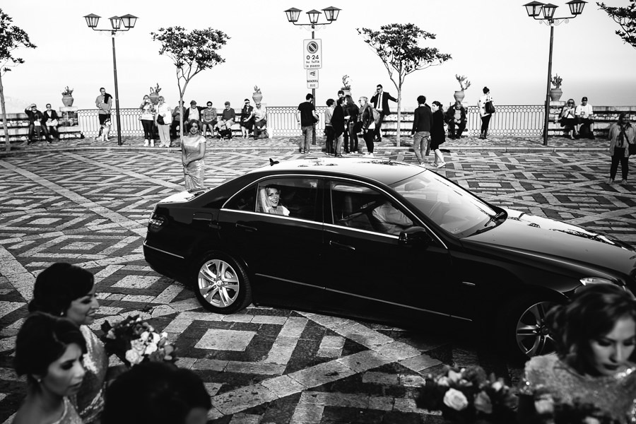 drive arriving by car for wedding ceremony at Castelmola Castle